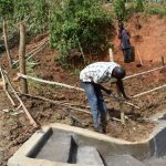 The Water Project: Maraba Community, Shisia Spring -  Setting Up Protective Fence