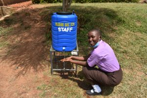The Water Project:  Brendah Using A New Handwashing Station