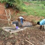 The Water Project: Maraba Community, Shisia Spring -  Planting Grass Around Spring