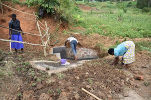 The Water Project:  Planting Grass Around Spring