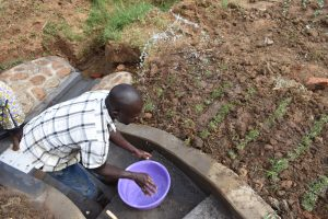 The Water Project:  Watering Freshly Planted Grass