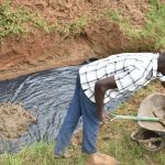 The Water Project: Maraba Community, Shisia Spring -  Pouring Concrete Foundation
