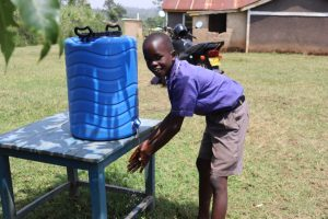 The Water Project:  Christopher Handwashing At A New Station