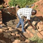 The Water Project: Maraba Community, Shisia Spring -  Plastering The Stone Pitching