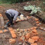 The Water Project: Mukhonje B Community, Peter Yakhama Spring -  Raising The Walls