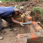 The Water Project: Mukhonje B Community, Peter Yakhama Spring -  Setting The Discharge Pipe