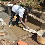 The Water Project: Mukhonje B Community, Peter Yakhama Spring -  Plastering The Stairs
