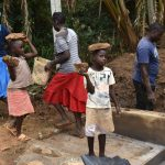 The Water Project: Mukhonje B Community, Peter Yakhama Spring -  Kids Participate By Carrying Small Rocks