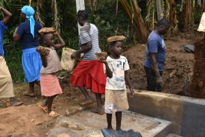 The Water Project:  Kids Participate By Carrying Small Rocks