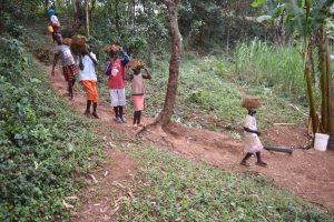 The Water Project:  Children Carrying Grass To Plant At The Spring