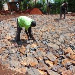 The Water Project: Kitagwa Secondary School -  Preparing The Rock And Wire Foundation