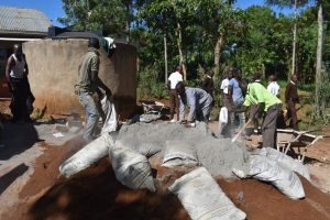 The Water Project:  Community Members Mix Cement And Concrete