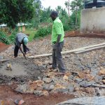 The Water Project: Kitagwa Secondary School -  Pouring Concrete Foundation