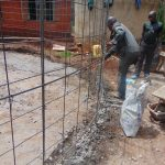 The Water Project: Kitagwa Secondary School -  Lining Up Wire With Foundation