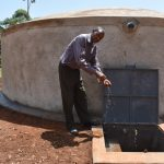 The Water Project: Kitagwa Secondary School -  Sanitation Teacher Celebrating Water On Campus