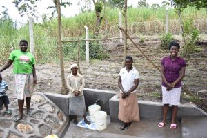 The Water Project:  Happy Women Pose At The Spring