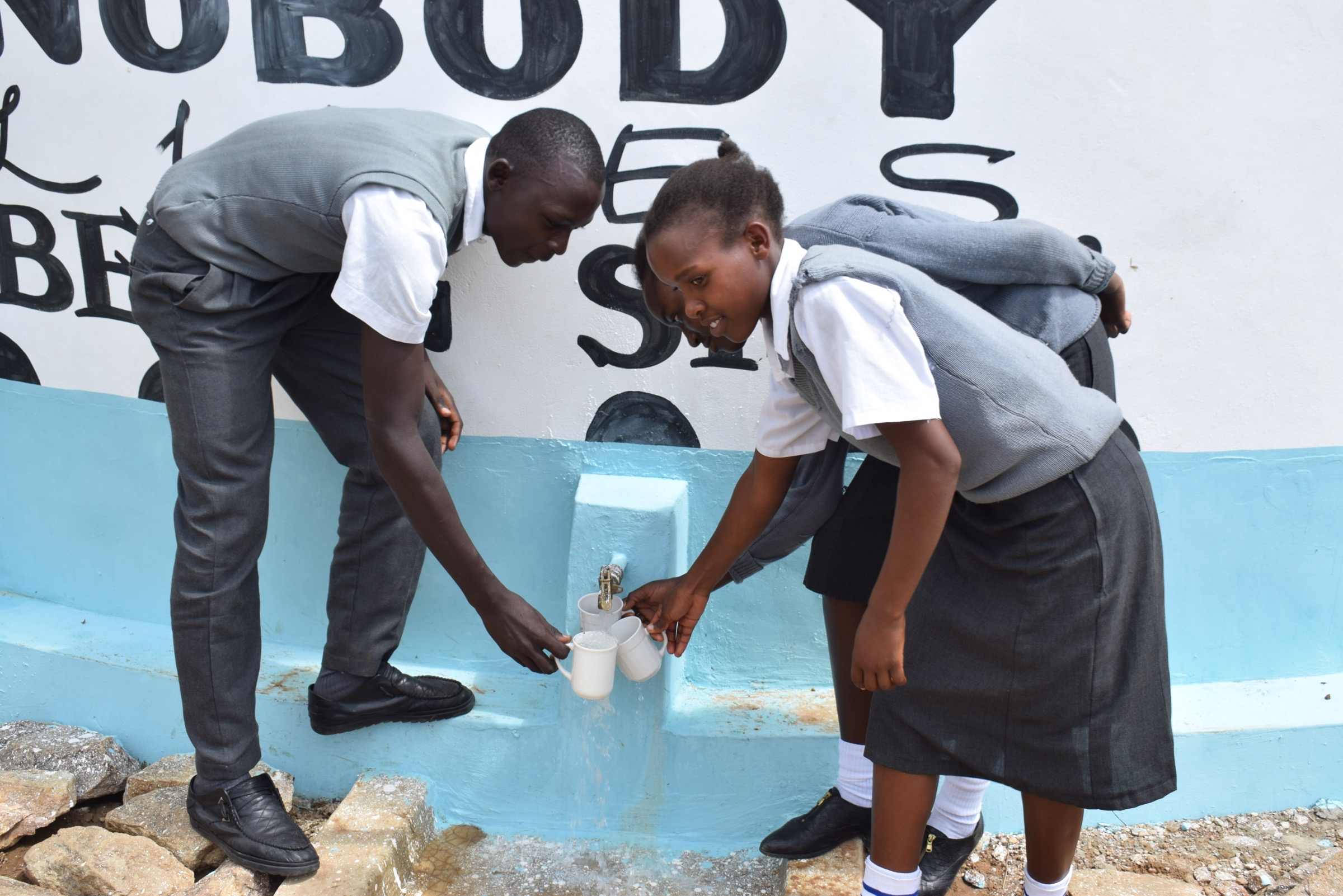 The Water Project : kenya20357-filling-up-at-the-tank