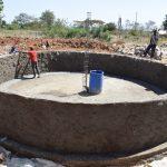 The Water Project: Kaketi Secondary School -  Working On Interior Tank Walls