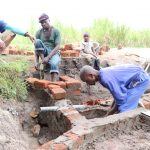 The Water Project: Kalenda A Community, Moro Spring -  Setting The Discharge Pipe