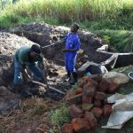 The Water Project: Kalenda A Community, Moro Spring -  Clearing The Area For Stairs Construction