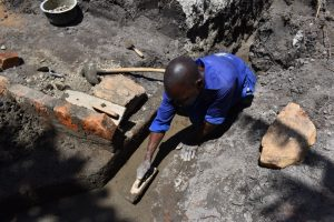 The Water Project:  Plastering The Drainage Channel Exit