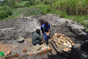 The Water Project:  Arraging Stones For The Rub Walls
