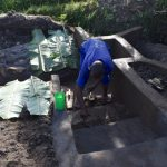 The Water Project: Kalenda A Community, Moro Spring -  Plastering The Stairs