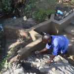 The Water Project: Kalenda A Community, Moro Spring -  Plastering The Walls