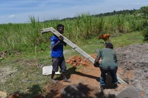 The Water Project:  Raising The Poles For Fencing