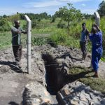 The Water Project: Kalenda A Community, Moro Spring -  Fencing Off The Drainage Channel