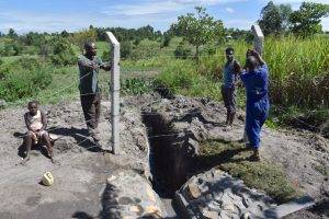 The Water Project:  Fencing Off The Drainage Channel