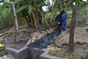 The Water Project:  Backfilling With The Tarp