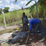 The Water Project: Kalenda A Community, Moro Spring -  Backfilling With Soil