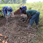 The Water Project: Kalenda A Community, Moro Spring -  Community Members Help Mix Concrete
