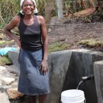 The Water Project: Kalenda A Community, Moro Spring -  Catherine Collecting Water