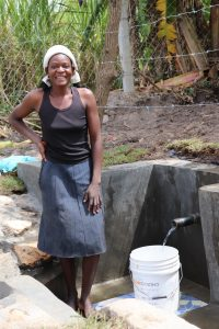 The Water Project:  Catherine Collecting Water