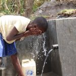 The Water Project: Kalenda A Community, Moro Spring -  Faith Cools Off In The Water