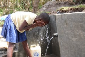 The Water Project:  Faith Cools Off In The Water