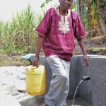 The Water Project: Kalenda A Community, Moro Spring -  Moses Sunguti Leaving With Clean Water
