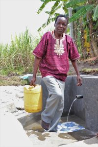 The Water Project:  Moses Sunguti Leaving With Clean Water