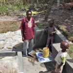 The Water Project: Kalenda A Community, Moro Spring -  Moses And Kids At The Spring