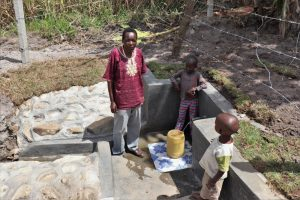 The Water Project:  Moses And Kids At The Spring