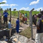 The Water Project: Kalenda A Community, Moro Spring -  Onsite Training With Field Officer Amos And The Artisan