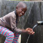 The Water Project: Kalenda A Community, Moro Spring -  Samwel Enjoying The Water