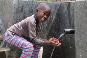 The Water Project:  Samwel Enjoying The Water