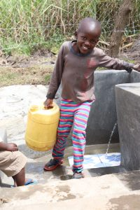 The Water Project:  Samwel Leaving With Clean Water
