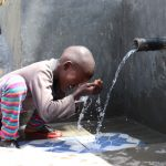 The Water Project: Kalenda A Community, Moro Spring -  Samwel Washes His Face