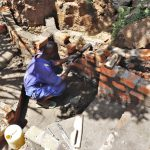 The Water Project: Luyeshe Community, Khausi Spring -  Setting The Discharge Pipe