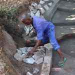 The Water Project: Luyeshe Community, Khausi Spring -  Setting The Stones For Rub Walls