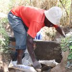 The Water Project: Luyeshe Community, Khausi Spring -  Plastering The Inside Of The Headwall